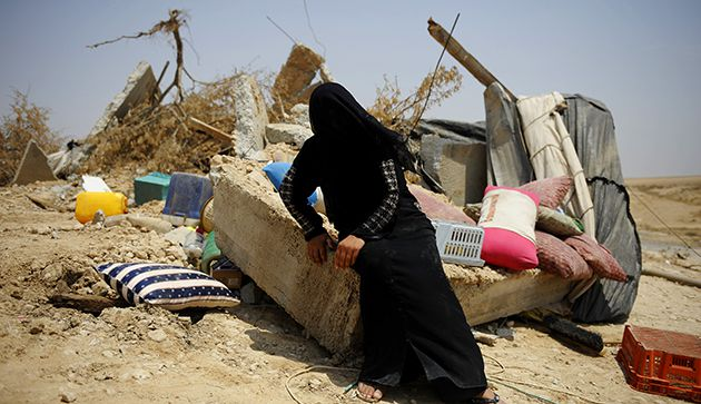 What Remains: In the village of Al-Arakib, a Bedouin woman sits amid the ruins of her family?s house, demolished last year by Israeli officials because it was built without a government permit.