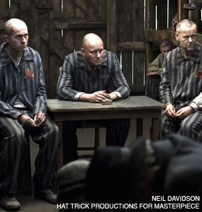 SITTING IN JUDGMENT: Schmidt (Stephen Dillane), Baumgarten (Stellan Skarsgård) and Jacques (François Guérary) listen to arguments about the possibilities of evil.