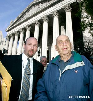 INDICTED: Ben-Ami Kadish (right) is escorted out of federal court in New York, where the 84 year old was charged April 22 with spying for Israel from 1979 to 1985
