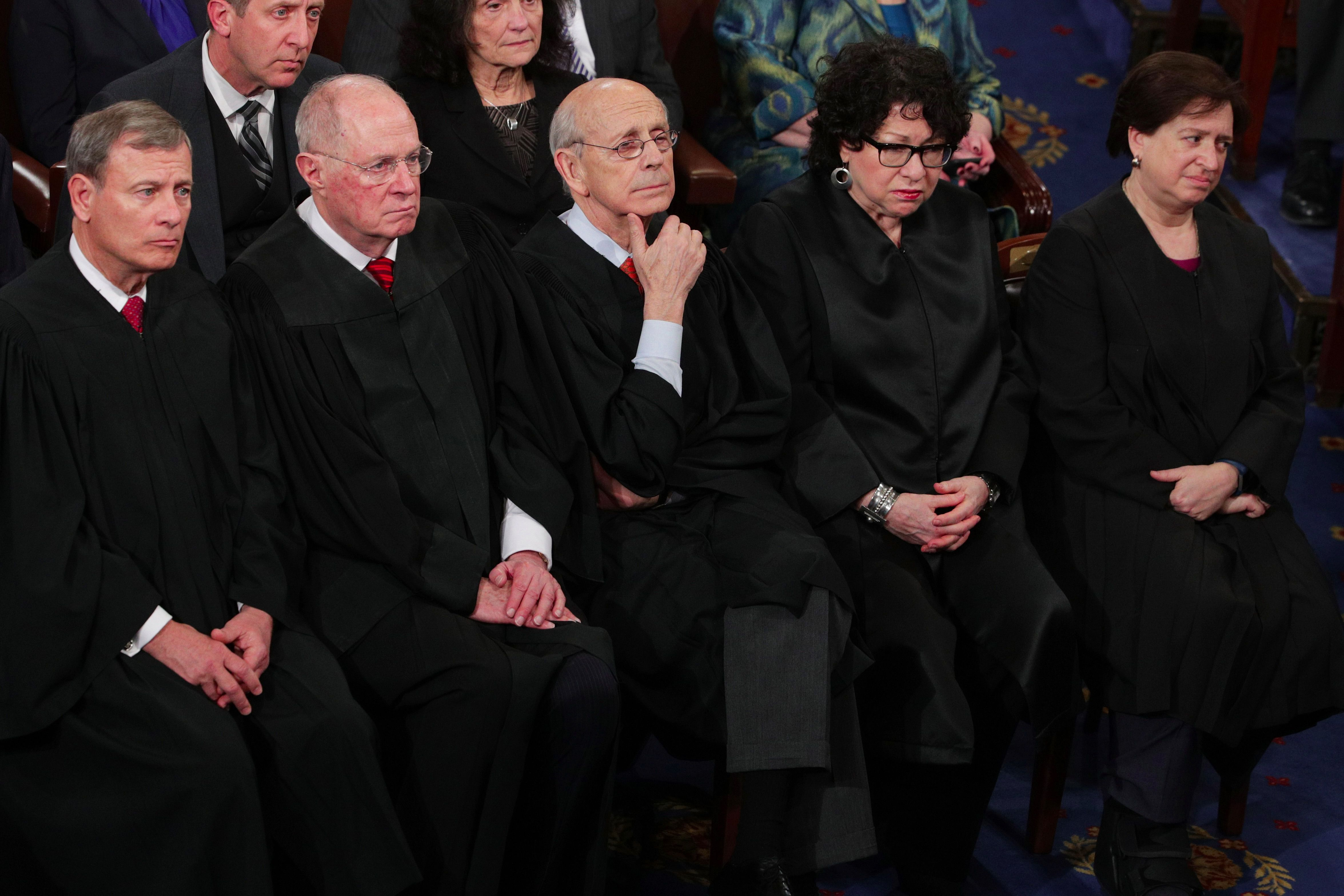 Supreme Court Justices listening to President Trump.