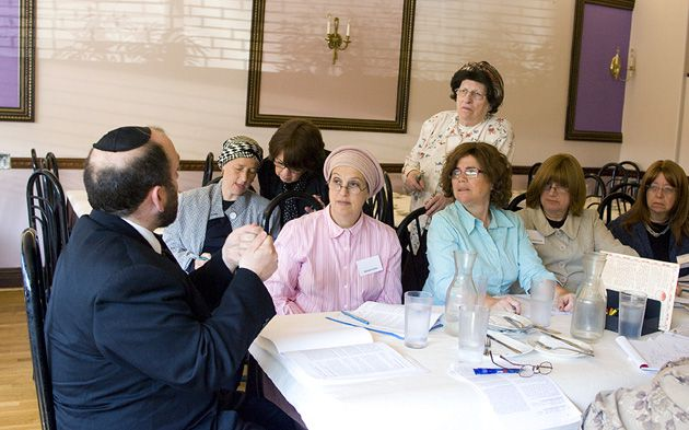 A Seat at the Table?: Rabbi Dov Schreier leads a class at a kosher restaurant in Brooklyn.