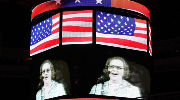 Raising Her Voice in Solemn Prayer: Kate Smith, seen here on a scoreboard before a Philadelphia Flyers hockey game, asked Irving Berlin to give her a song to sing on Armistice Day. He responded with ?God Bless America.?