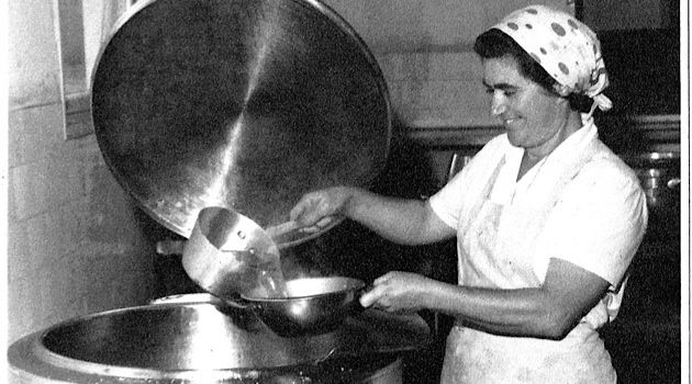 What?s for Dinner: A kibbutz member helps prepare a meal at Kibbutz Mefalsim in 1960.