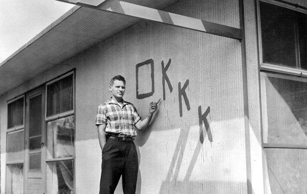 It?s Not OK: Lew Wechsler points to the side of his home.