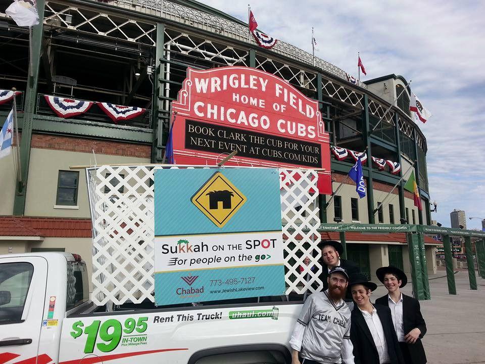 Chabad rabbi Dovid Kotlarsky takes his Sukkah=mobile to Wrigley Field.