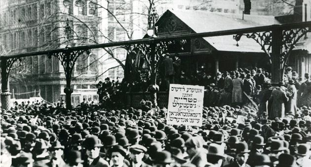 Still Troubled: The sign held by these 1910 demonstrators in Union Square reads ?Our leaders say the strike is over, this demon- stration shows otherwise.?