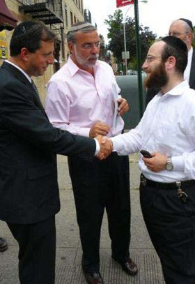 Reaching out: City Council candidate Brad Lander (left) campaigns in Boro Park with State Assemblyman Dov Hikind (center).