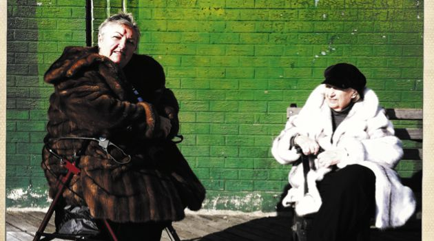 Fur in Spring: Russian women lounge on Brighton Beach's boardwalk.