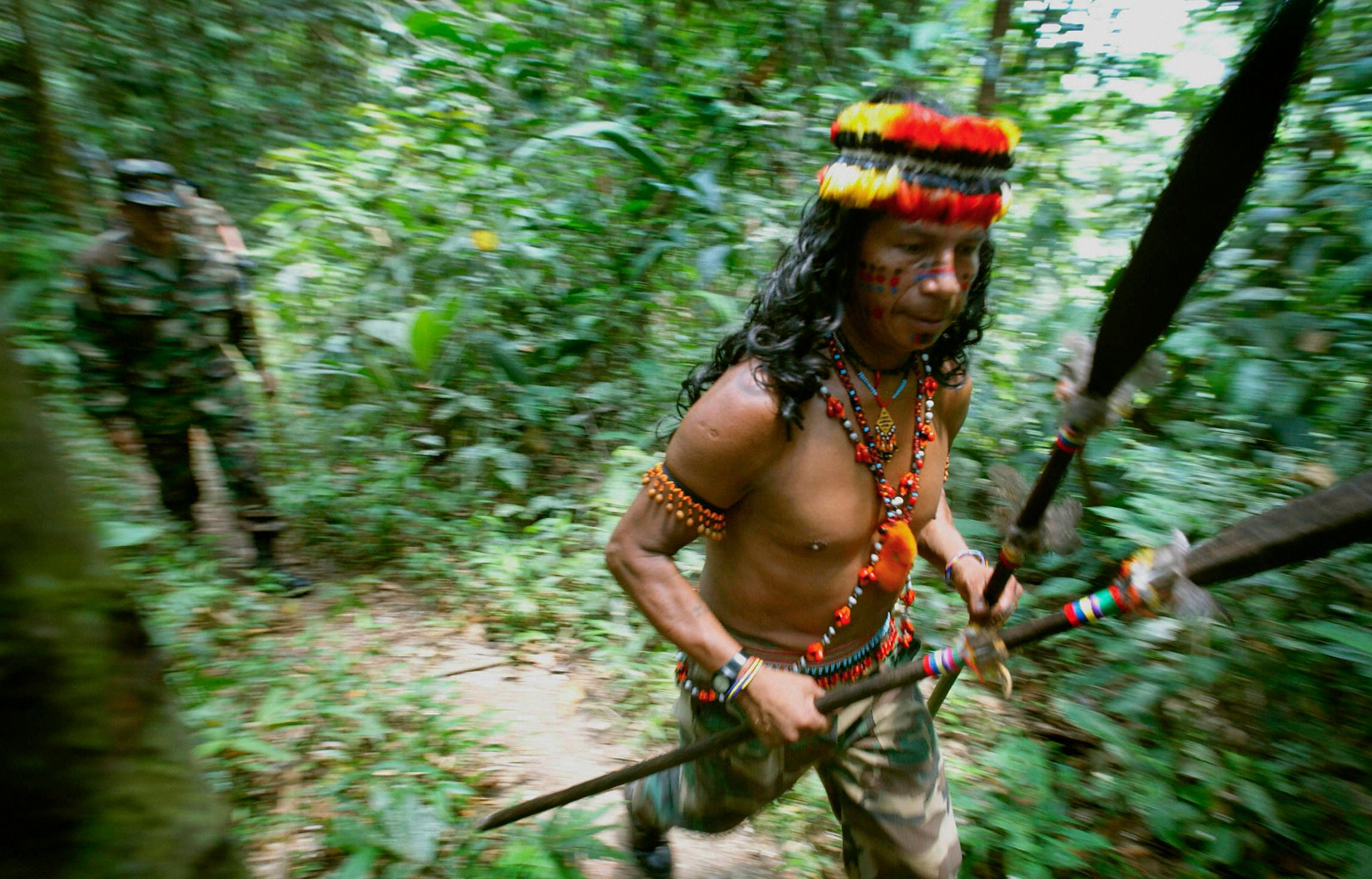 You Can Run... : An Amazonian tribesman flees an ADL research team.
