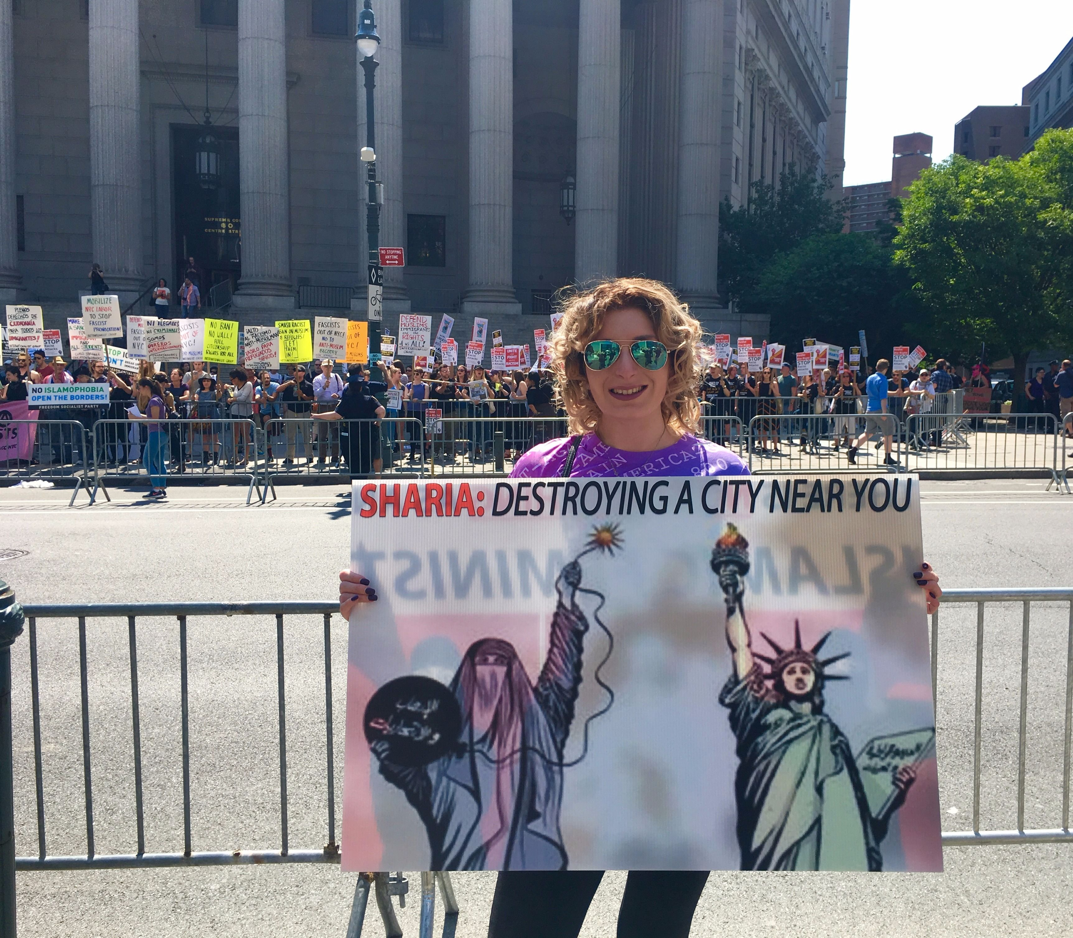 Fr-right activist Laura Loomer holds a one-woman counter-protest.