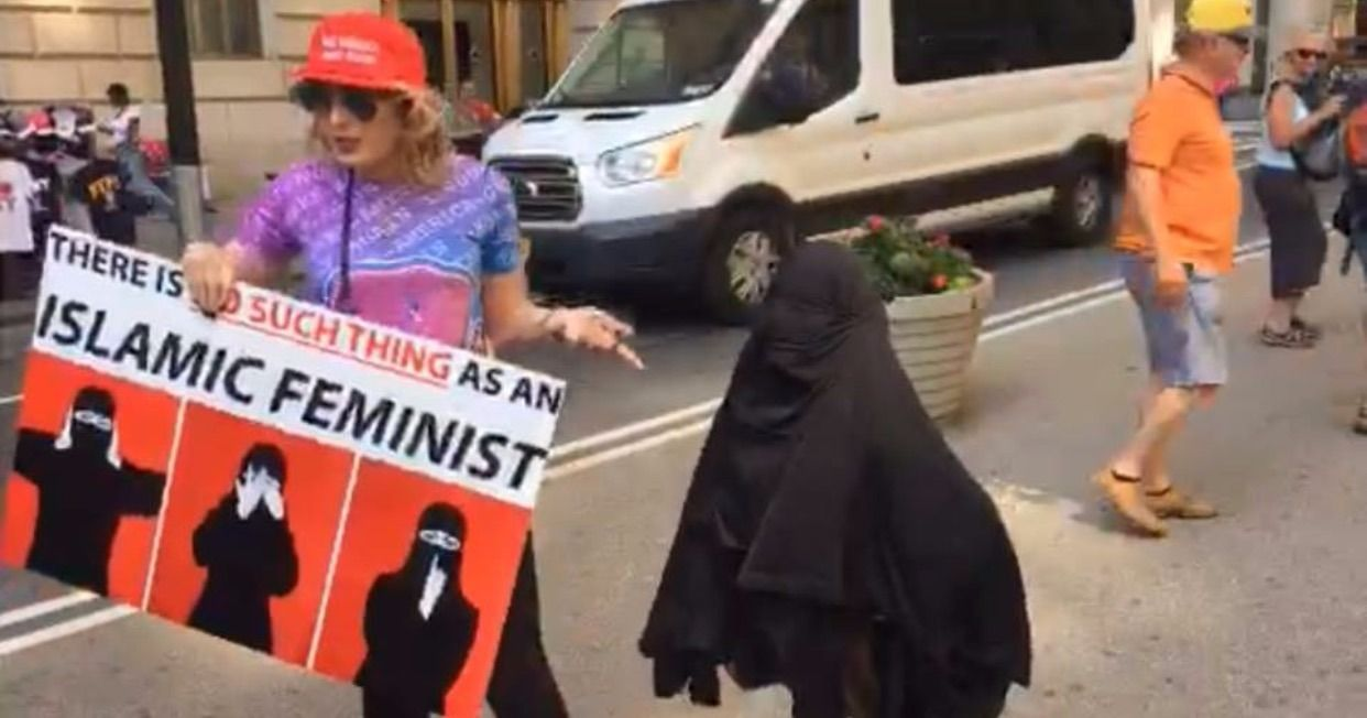 "Laura Loomer put a burqa on the ""Fearless Girl"" statue in New York's Financial District during the March Against Sharia on June 10th."