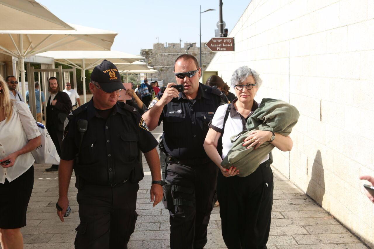 Lesley Sachs is arrested on June 7 with a Torah scroll at the Western Wall.