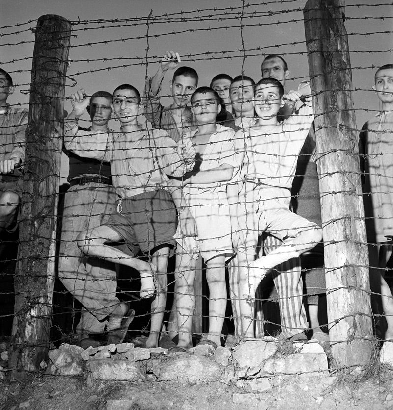 Free at Last: Prisoners at Buchenwald gathered following the camp?s liberation. (click for larger view)