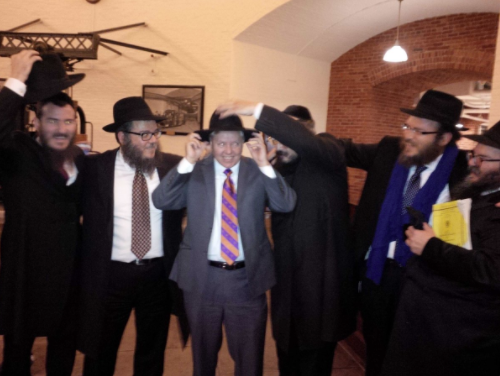 Lindsey Graham admired these Orthodox fellows's fedoras.