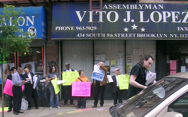 Signs Of The Times: Protesters gather outside the Brooklyn offices of Assemblyman Vito Lopez, who helped scuttle a bill to make it easier for victims of sexual abuse to sue their molesters and institutions that helped enable or cover up the abuse.