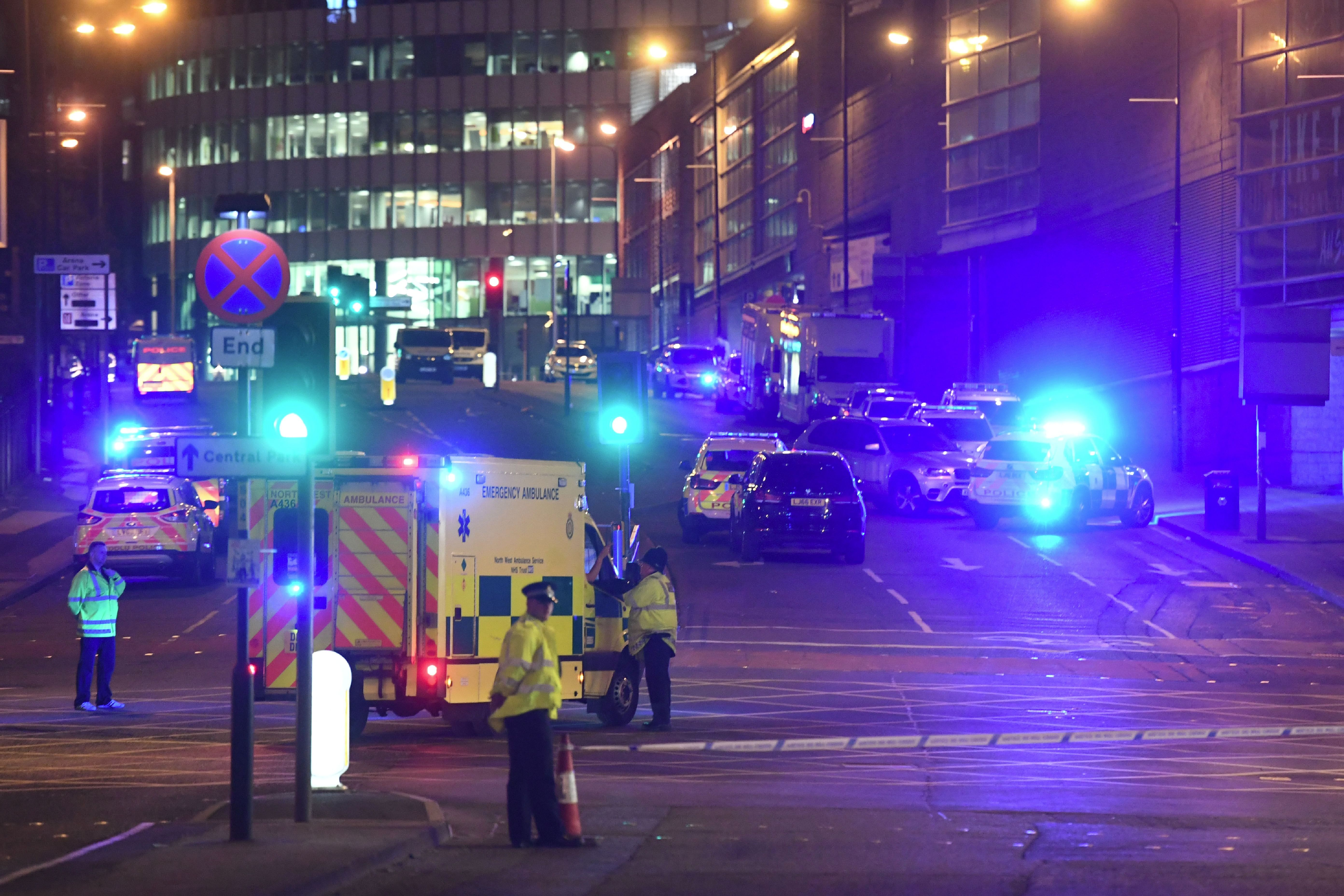 Emergency response vehicles are parked at the scene of a terrorist attack during a concert by Ariana Grande in Manchester, England, May 23, 2017.