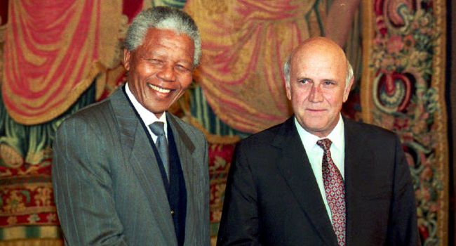 Former Enemies: Nelson Mandela and then South African President Frederik de Klerk shake hands at the Grand Hotel in Oslo on the evening before receiving jointly the Nobel Peace prize in 1993.
