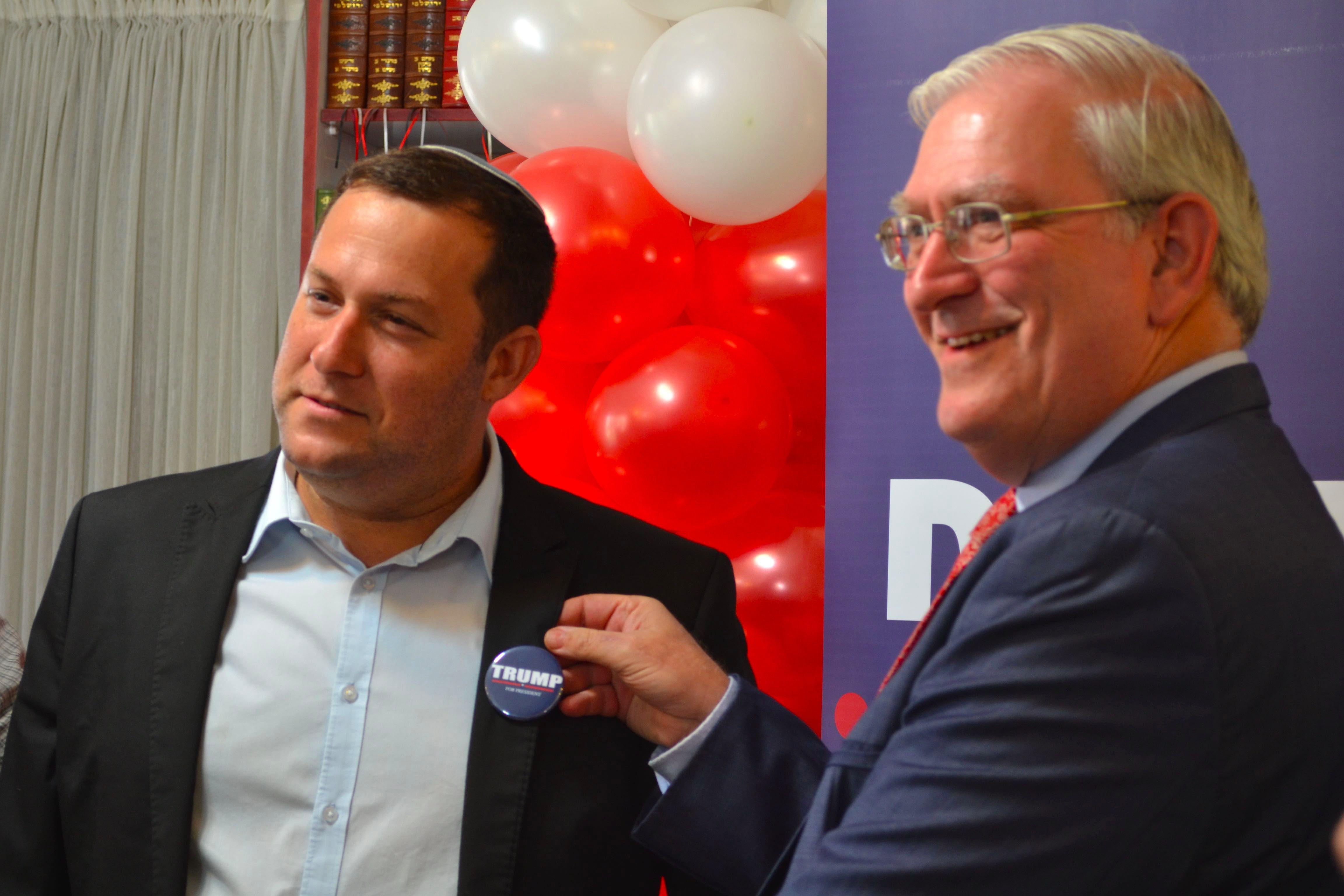 Marc Zell of Republican Overseas Israel (right) pins a Trump pin on settler leader Yossi Dagan.