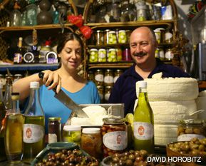 THE CHEESE SHOP: Sigal and Ziv Schwartzman help customers at their shop and museum in Bat Shlomo, a Zionist settlement near Haifa.