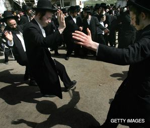 BATTLEGROUND: Ultra-Orthodox men dance during last year?s annual yahrzeit celebration at the grave of Rabbi Shimon bar Yohai. Two feuding trusts are embroiled in an acrimonious battle over control of the site.