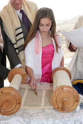 Proud Pappy: Gerald Eskenazi and his granddaughter, Alexa, during her bat mitzvah at Masada.