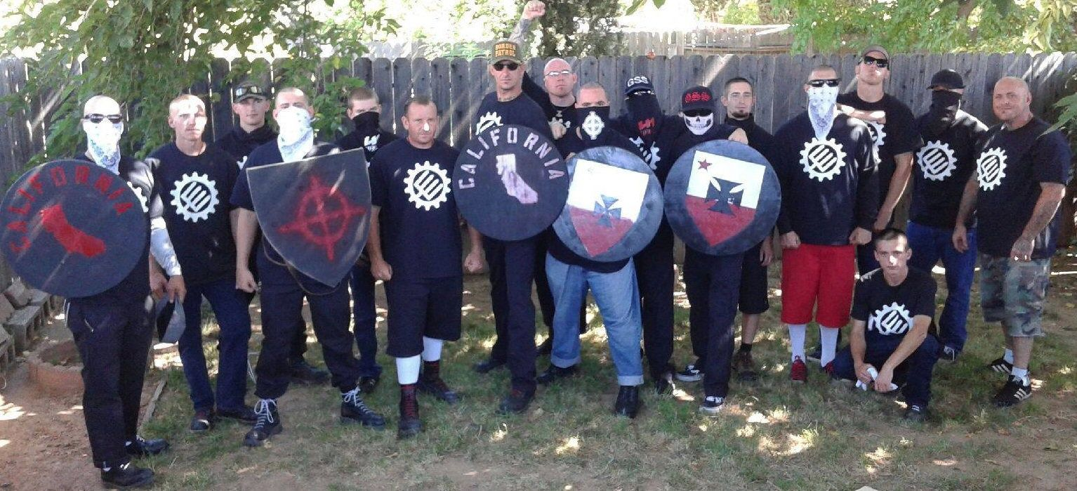 The Traditionalist Workers Party poses for a photo before heading to what would become a bloody pro-Trump rally in Sacramento, California, on Sunday.