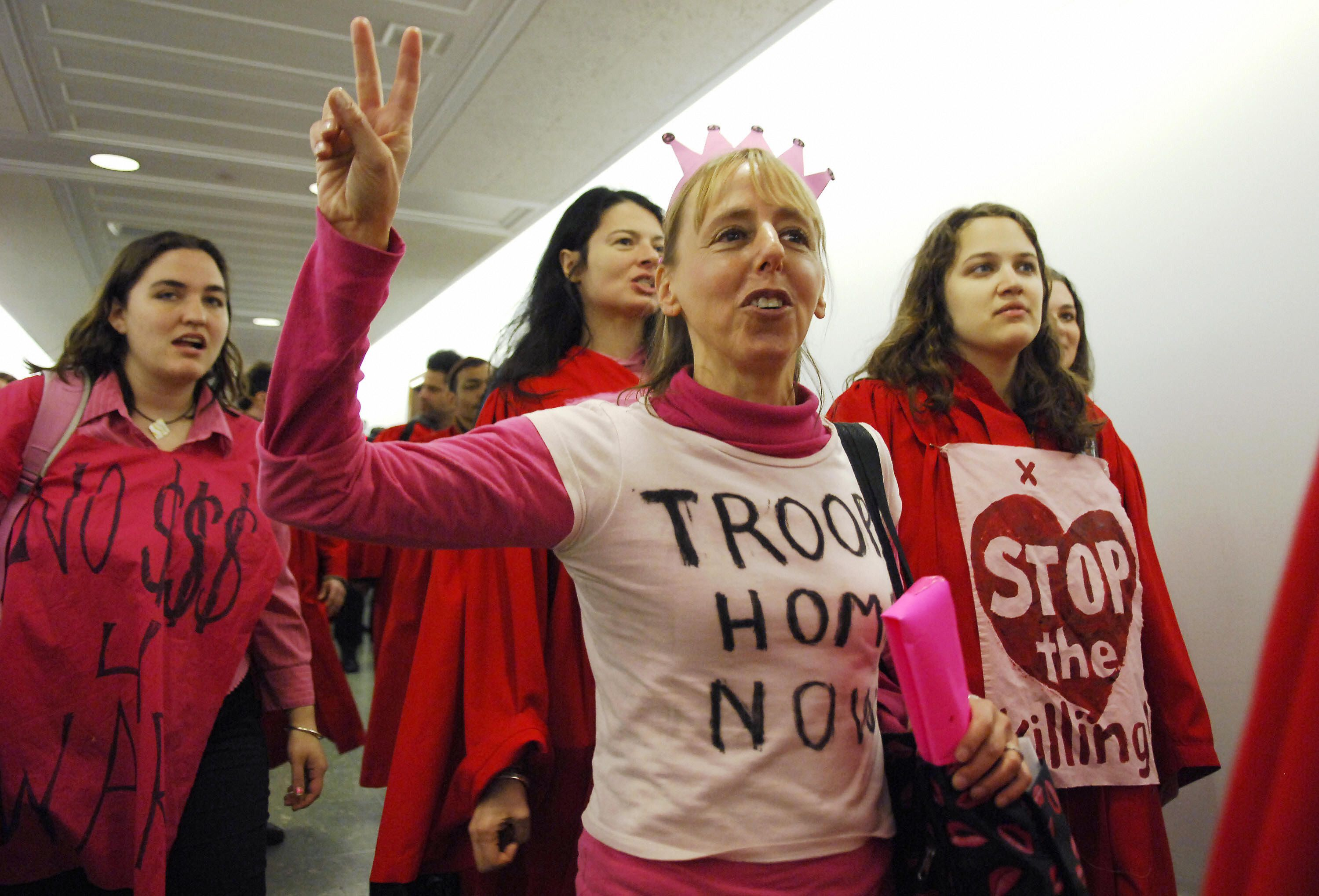 Medea Benjamin, cofounder of anti-war group CodePink and human rights organization Global Exchange, and fellow activists chant as former US Vice President Al Gore testifies before the Senate Global and Public Works Committee on Capitol Hill in Washington, DC, 21 March 2007.