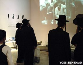 NEW VISITORS: A group of ultra-Orthodox visitors look at a display in the Yad Vashem memorial and museum, which has made a strenuous effort to reach out to Israel?s religious community.