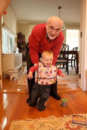 A Steady Hand: Professor Jeremy Zwelling helps Orli take a few steps.