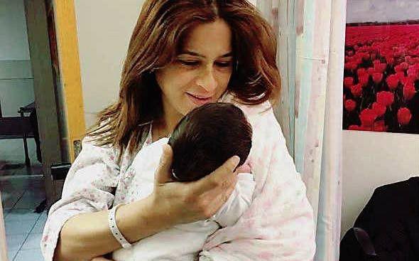 Merav Ben Ari holds her baby daughter Ariel.