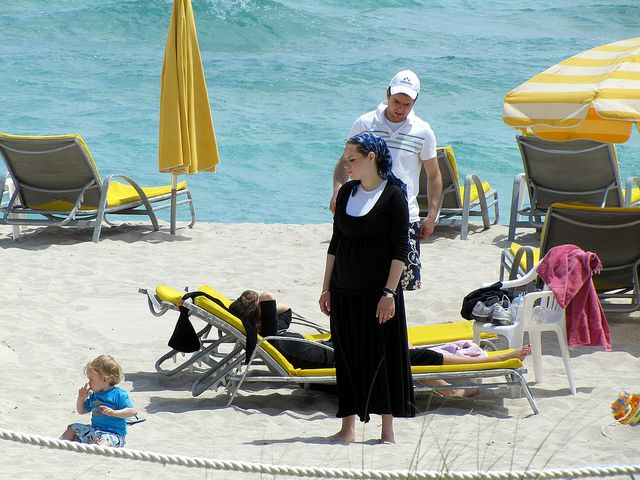 Beach Day: An Orthodox Jewish woman takes in some sun in Miami.