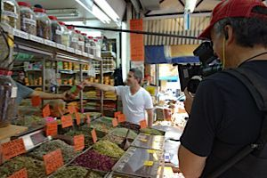 Chef Michael Solomonov and filmmaker Roger Sherman shopping at a spice store in Levinsky market.