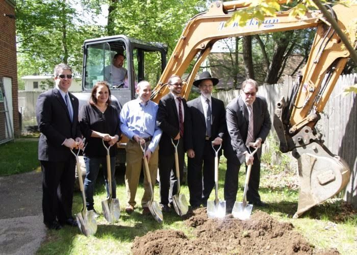 Ezra Schwartz's parents Ari and Ruth (second and third from left) at groundbreaking for the new mikvah.