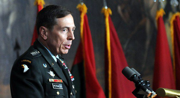 Speaking Out: U.S. Army general David Petraeus leads a Holocaust remembrance cer- emony inside the Capitol.