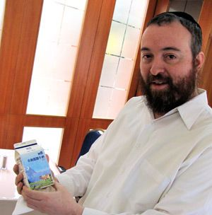 Milking it: Rabbi Shalom Greenberg of the Shanghai Jewish Center.