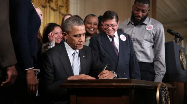 President?s Order: Barack Obama signs an executive order to raise the minimum wage for federal contractors from $7.25 to $10.10 during an East Room event on February 12.