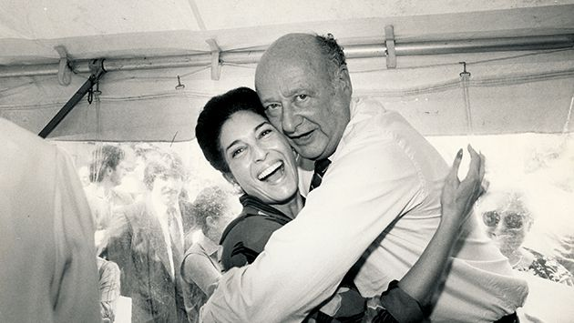 Hugging Hizzoner: Slovin feels Mayor Koch?s love for her project at the groundbreaking event for the museum in 1986.