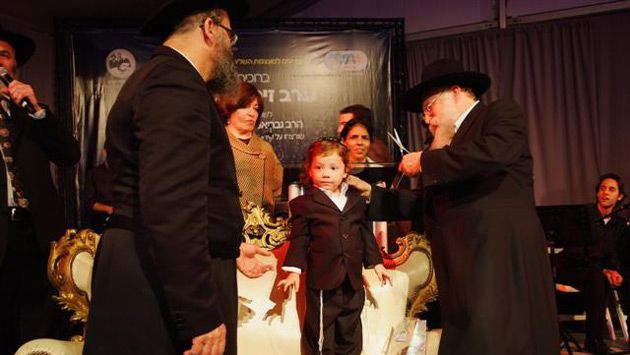 My New Earlocks: Moshe Holzberg, a son of the two Chabad emissaries murdered in last November?s Mumbai terror attacks has his 3-year-old locks cut at a traditional upsherin ceremony which brought out thousands in Kfar Chabad, Israel.