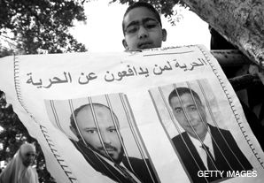 BARRED: The son of an arrested Muslim Brotherhood member protests in Cairo March 16.