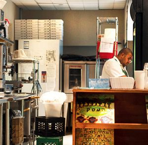 Well-treated?: A cook works in the kitchen of Cafe Nana in Manhattan.