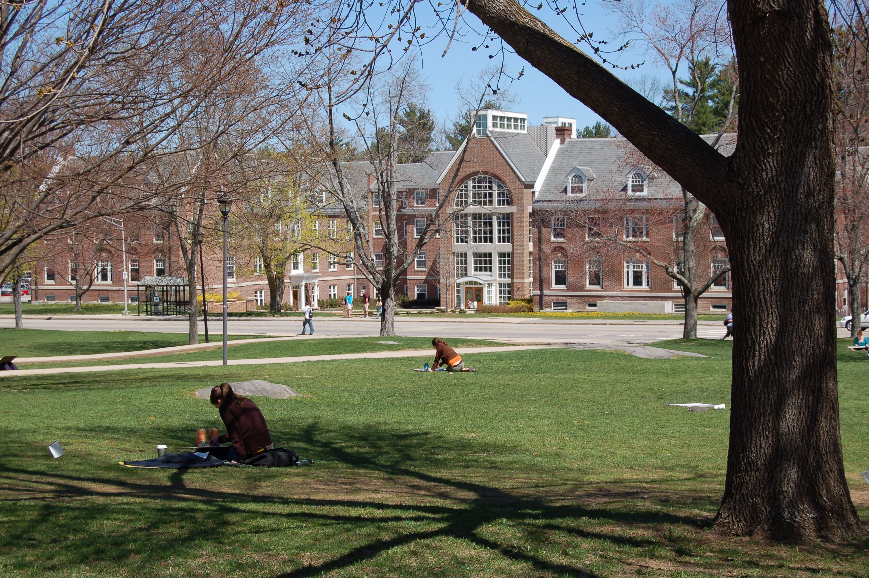 Students sit outside Congreve Hall at the University of New Hampshire