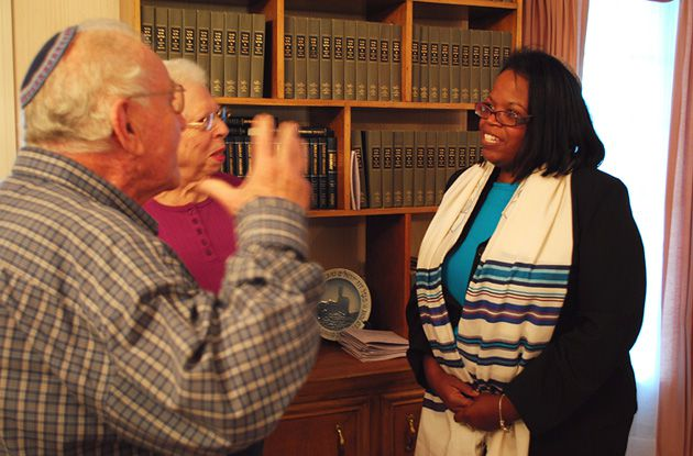 New Leader: Rabbi Alysa Stanton speaks with congregants at Bayt Shalom, where she recently took over as the head rabbi.