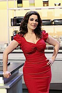 Lady in Red: Nigella Lawson seduces you ? not with her beauty alone, but with her charming personality and almost careless disregard for everything a female celebrity is supposed to look like.