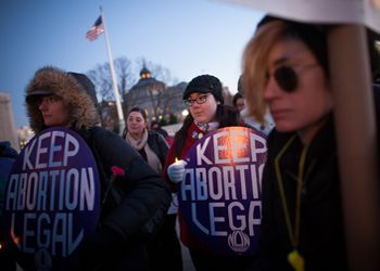 Activists commemorate the 40th anniversary of Roe v. Wade at a vigil in front of the U.S. Supreme Court on January 22, 2013.