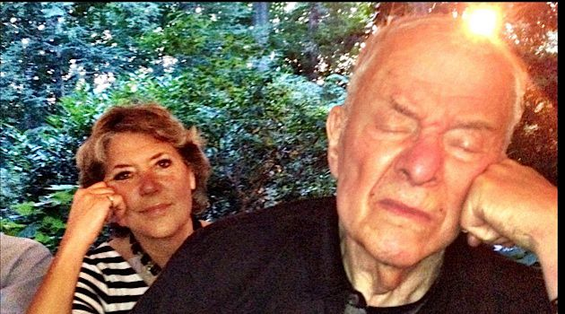 Source of Light: Kathleen Peratis behind Leonard Fein as he meditated on the speeches at his 80th birthday.