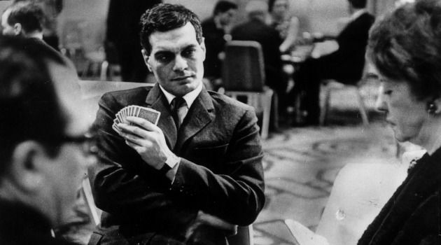 Not Playing: Academy Award nominated actor Omar Sharif, best known for roles in 'Funny Girl' and 'Doctor Zhivago,' said though he would personally play against Israelis at the World Bridge Olympics in 1963, he was told not to by Arab leaders. Seen here at the competition in 1966.