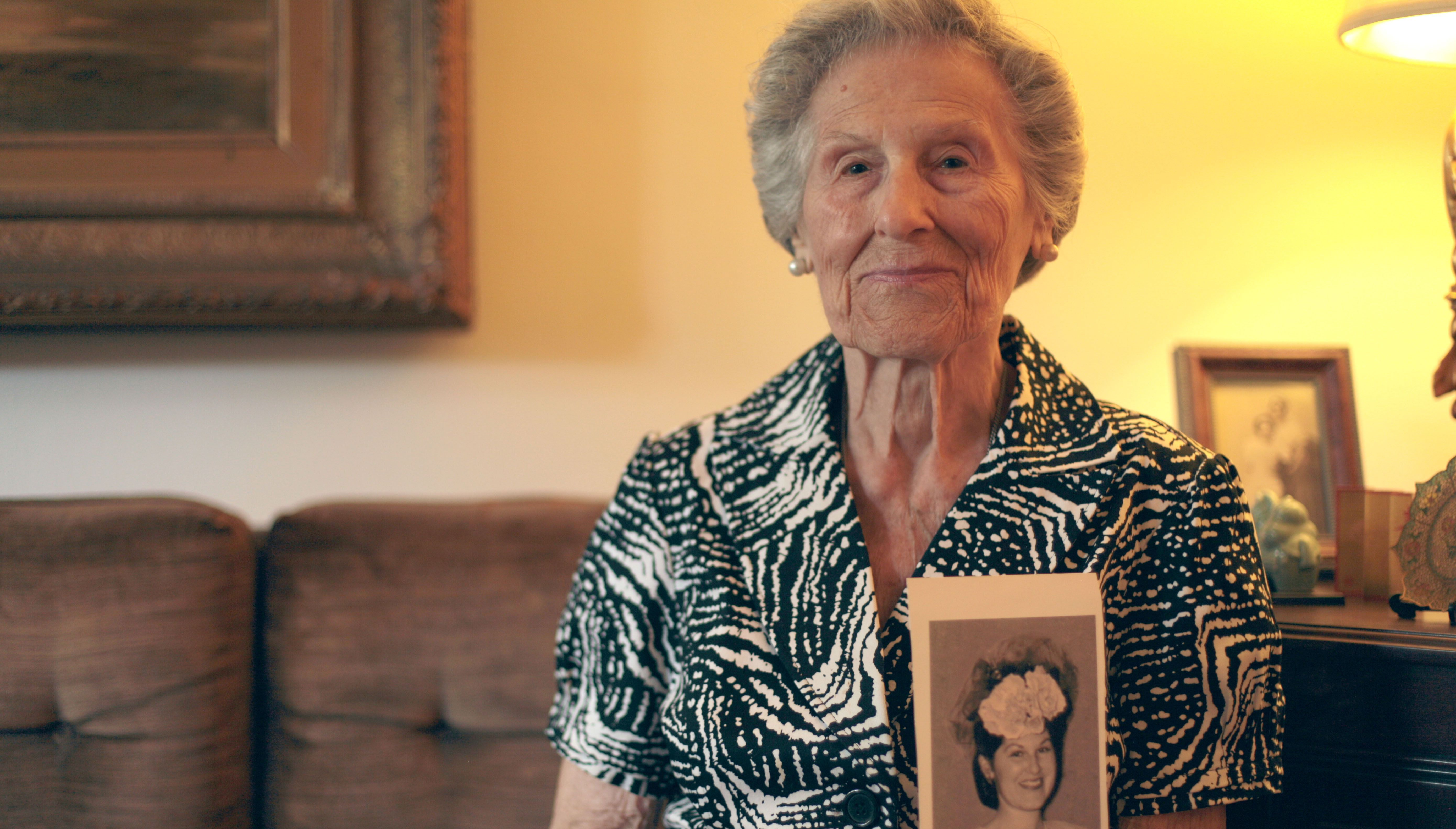 Now and Then: Molveine Karan, 98, holds a photo of herself taken 70 years ago at a friend's wedding.