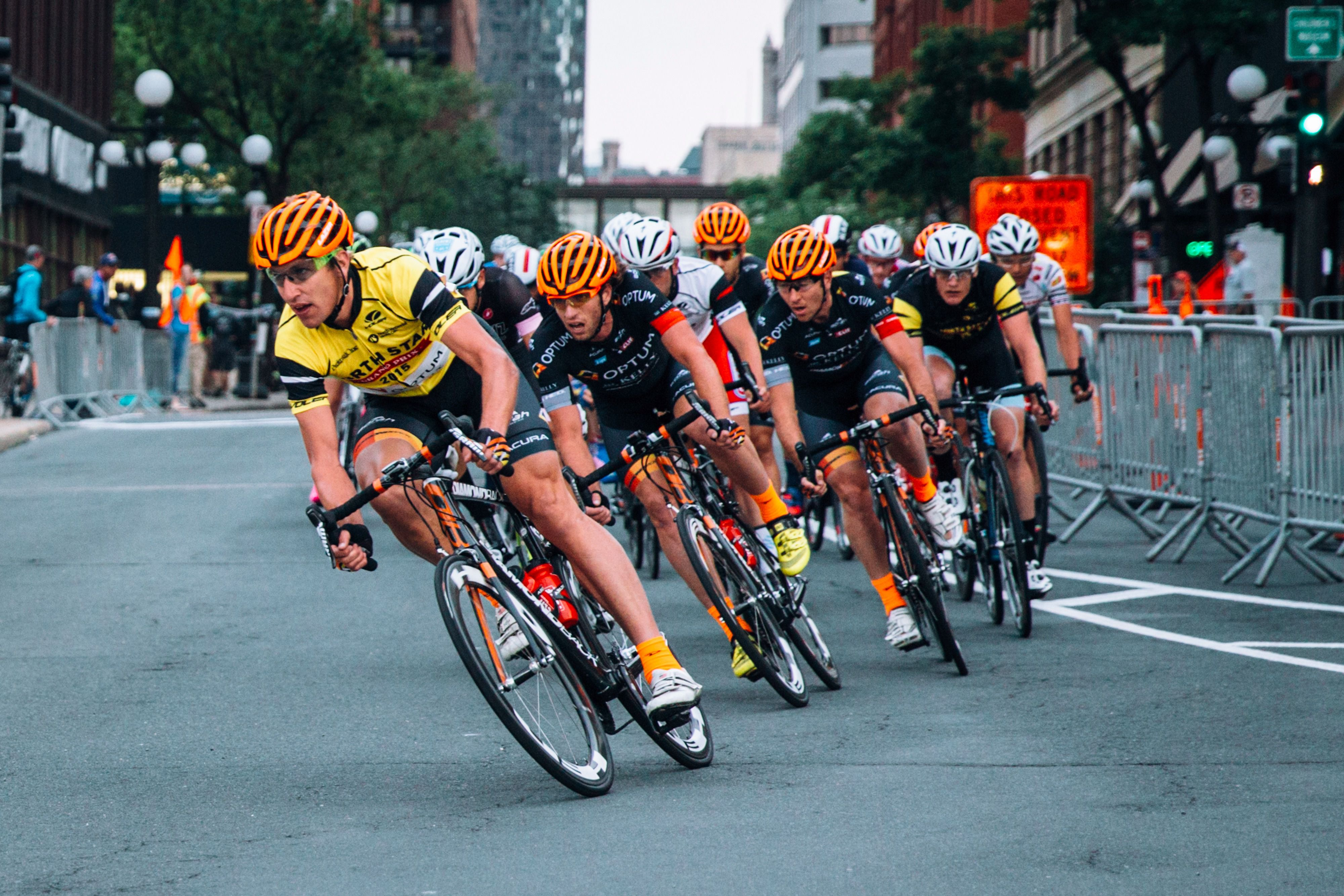In Action: Optum, America's top cycling team, in black outfits and orange helmets.