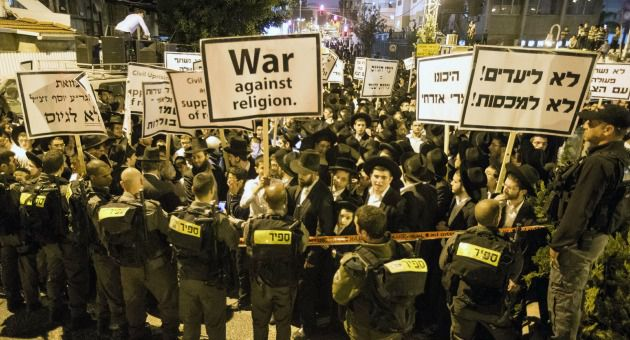 Ultra-Orthodox Jews gather in March 2014 to demonstrate against any plans to make them undergo military service.