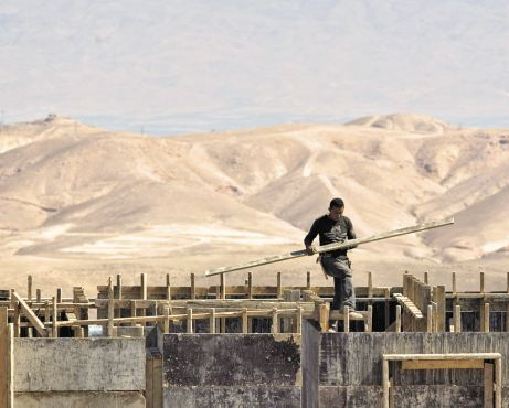 A Palestinian working in the West Bank settlement. In the 20 years since Oslo, an eastern bloc of settlements has been created, possibly thwarting future Palestinian development plans.